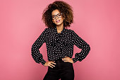 Portrait of beautiful smiling black woman wear glasses and black shirt with white peas