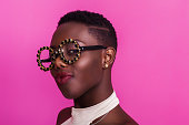 Beautiful african girl portrait wearing odd glasses and smiling