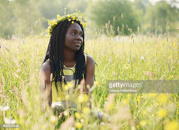 Beautiful African woman on a meadow