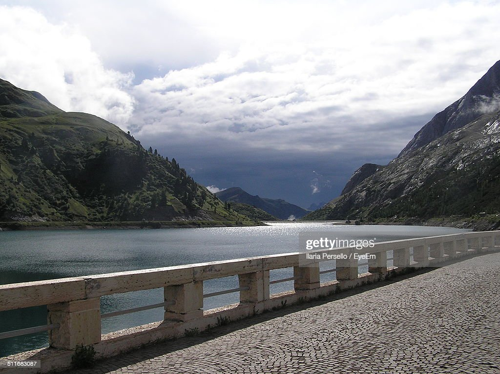 Beautiful alpine scenery with water and cloudy sky