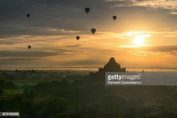 Beautiful Ancient Bagan city in the morning sunrise with balloons, Bagan, Mandalay, Myanmar