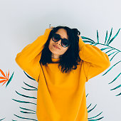 Beautiful and fashionable woman in accessories and sweatshirt. Stylish Hoody yellow trendy vibes