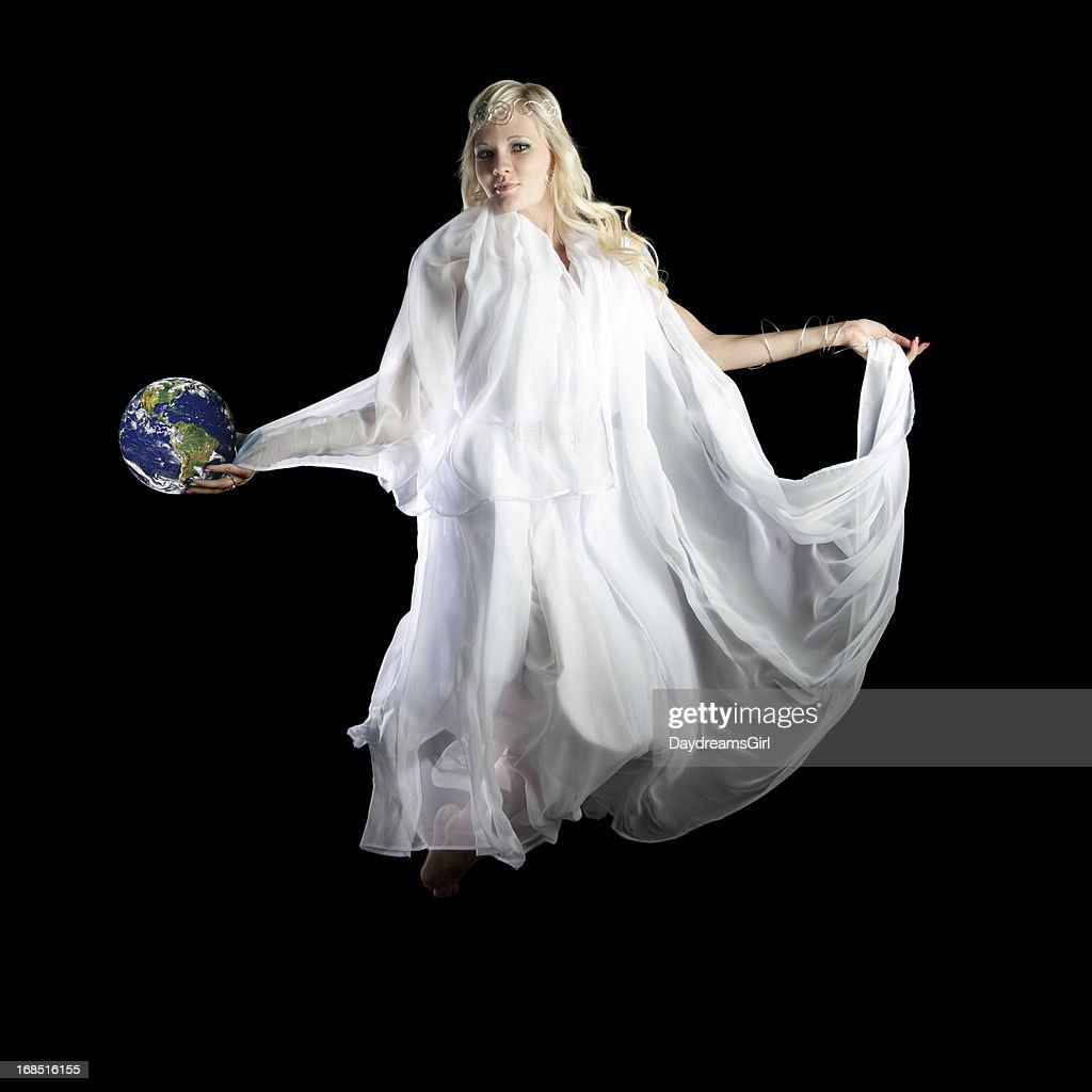 Beautiful Angel Flying and Holding Earth in Hand : Stock Photo