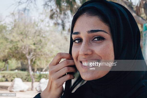 Beautiful Arab woman in smiling portrait outdoor