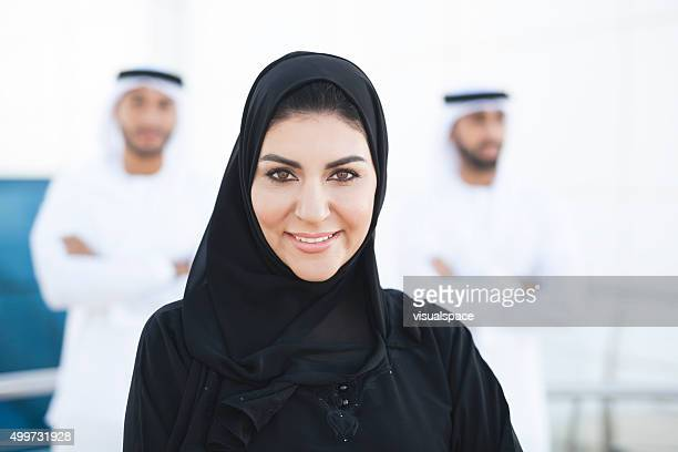 Beautiful Arabian Woman With Two Arab Men Standing Behind