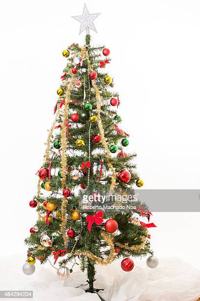 Beautiful arrangement of a Christmas tree over a white background
