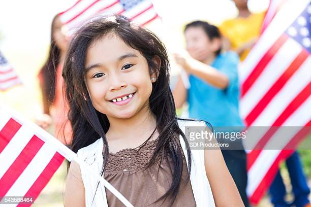 Beautiful Asian American little girl celebrating Independence Day