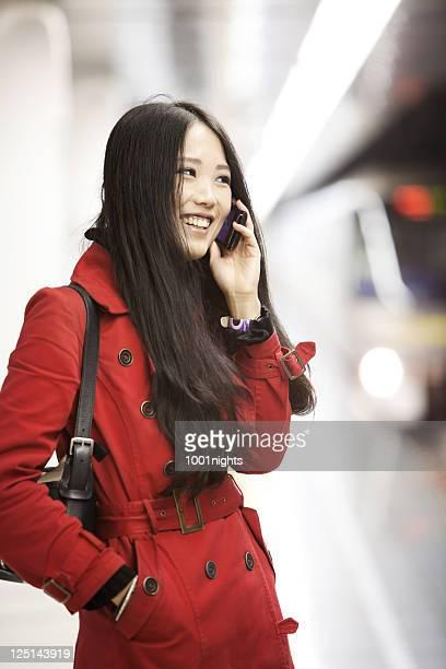 Beautiful Asian at the metro station