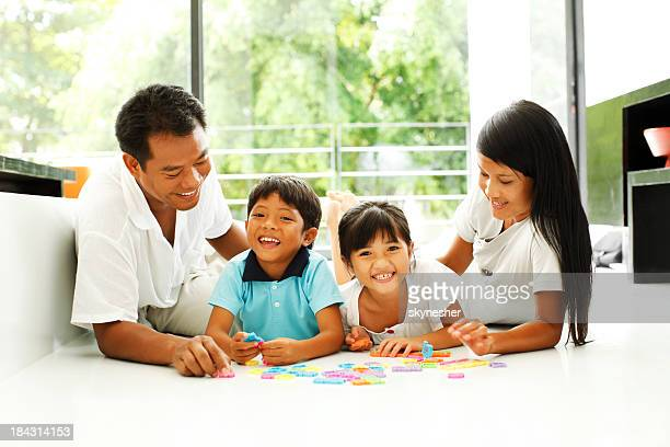 Beautiful Asian family enjoying at home.