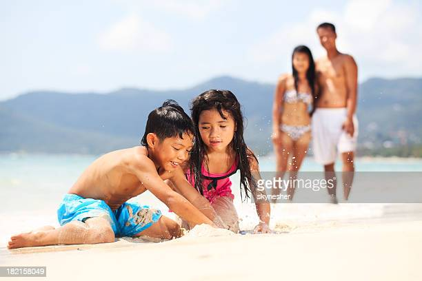 Beautiful Asian family on the beach