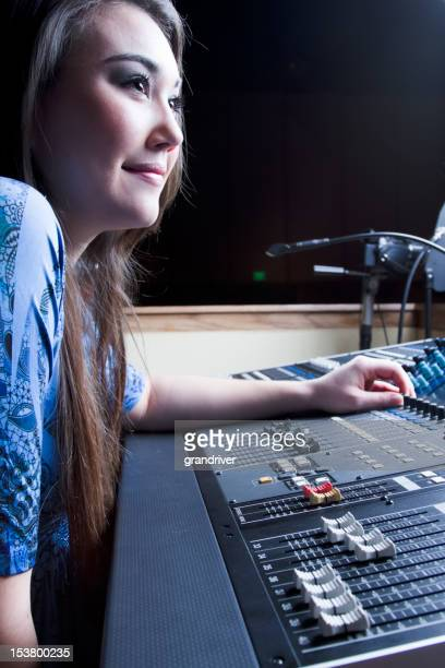 Beautiful Asian Girl in 20s at a Recording/Sound Console