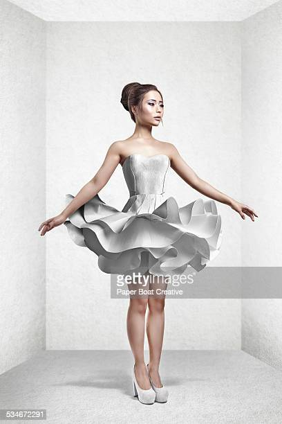 Beautiful Asian lady in white paper craft dress