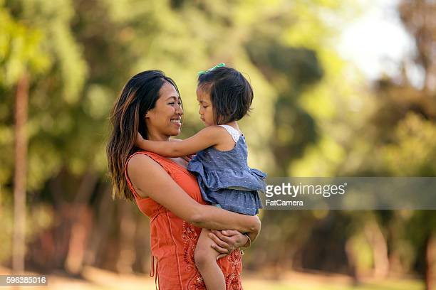 Beautiful Asian mother holding her daughter