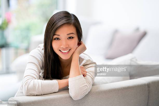 Beautiful Asian woman at home