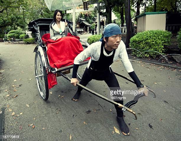 Beautiful asian woman pulled by a rickshaw