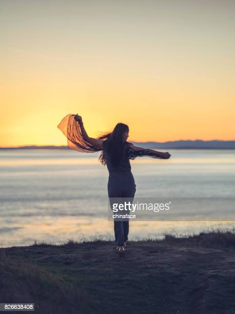 beautiful asian woman standing at Friday Harbor during sunset