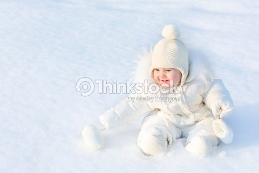 fc8cb3b9d2c9 Beautiful Baby Girl Wearing Warm White Snow Jacket And Hat Stock ...