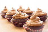 Beautiful background with chocolate cupcakes. Cupcakes with cream. Sweet dessert.