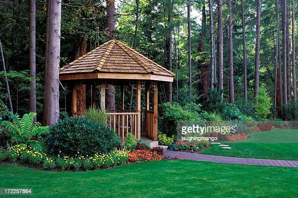 A beautiful backyard garden with a cedar wood gazebo