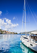 Beautiful bay with sailing boat, Croatian islands