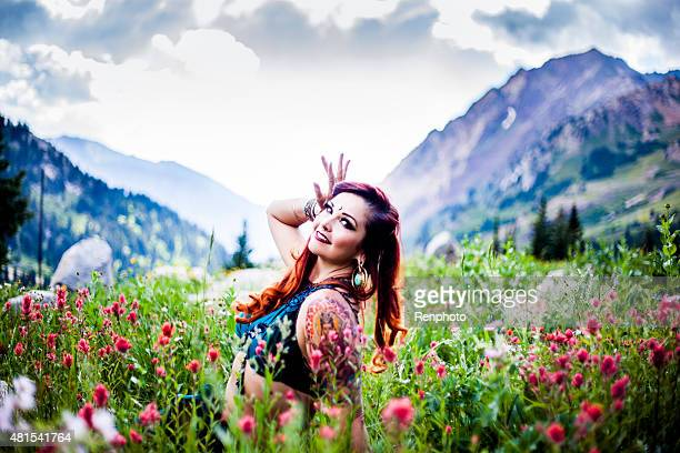 Beautiful Belly Dancer Sitting in a Field of Flowers