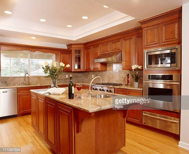 Beautiful big kitchen with island and wooden cupboards