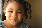Beautiful four year old Black Girl, smiling, with braids