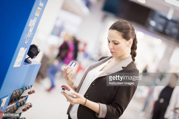 Beautiful black hair, young business woman shopping in supermarket