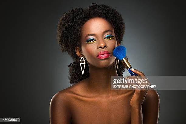 Beautiful black lady with makeup brush