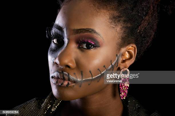 Beautiful black woman in sugarskull makeup, semi-profile.