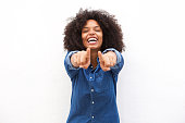 Portrait of beautiful black woman pointing fingers and laughing