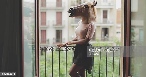 Beautiful black woman portrait with horse head