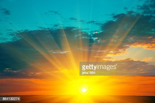 Beautiful blazing sunset landscape at over the meadow and orange sky above it. Amazing summer sunrise as a background. : Stock Photo