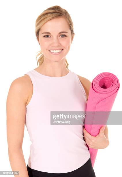 Beautiful blond female with pink yoga mat smiling bright