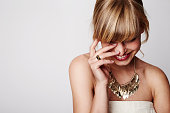 Beautiful blond laughing with gold necklace, close up