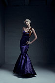 Beautiful Blond Young Woman Fashion Model in Evening Gown