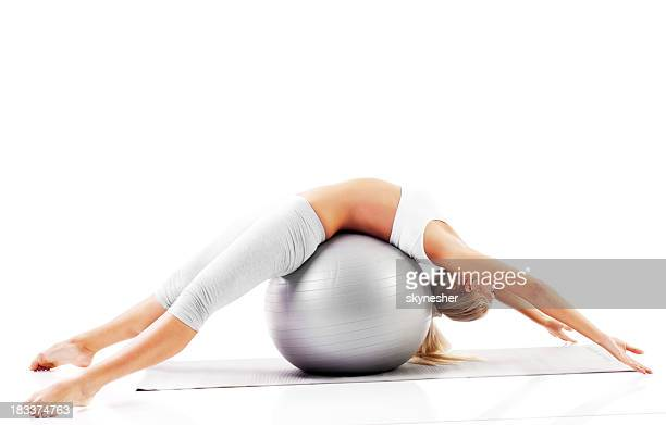 Beautiful blonde girl exercise Pilates.