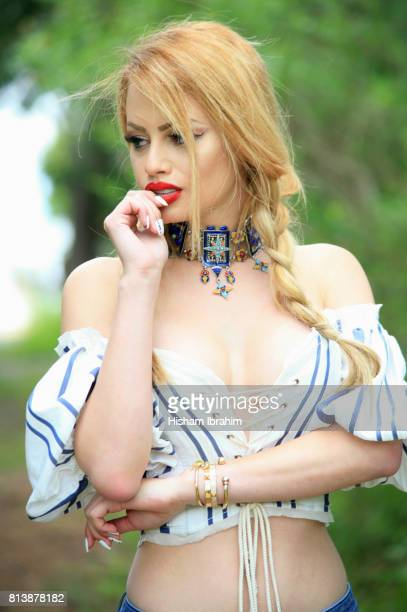 Beautiful blonde sexy young Latin woman with braided hair day dreaming.