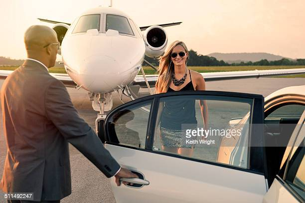 Beautiful blonde woman flying on a private jet.