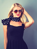 Beautiful young blonde woman in a black dress