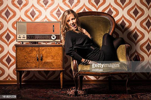 Beautiful Blonde Woman Listening Amazing News on Vintage Radio