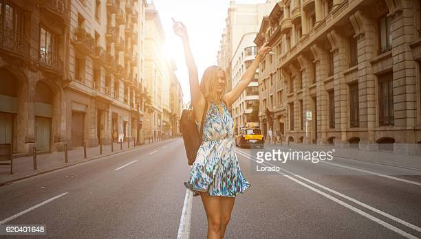 Beautiful blonde young woman student enjoying freedom in new city