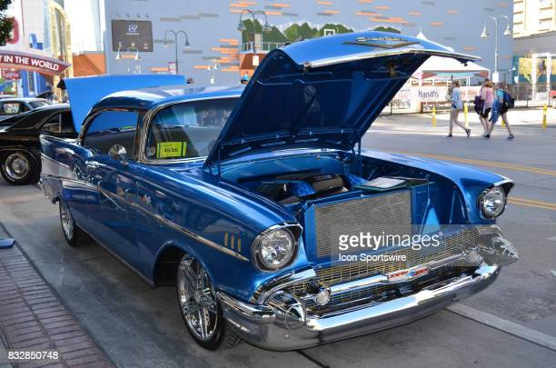 Beautiful blue 1957 Chevy Bel Air with matching colored engine compartment chrome rims and polished paint job on display at the Hot August Nights...