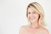 Beautiful blue eyed blond woman smiling at camera