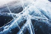Beautiful blue ice on the winter lake. Macro image, selective focus.