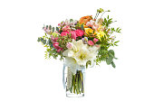 Beautiful bouquet of bright flowers in vase isolated on white