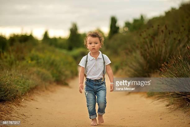Beautiful boy walking bare feet