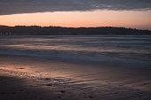 beautiful breaking waves on sandy beach on atlantic ocean, basque country, france