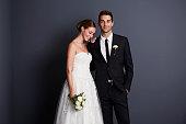 Beautiful bride and groom in studio, smiling