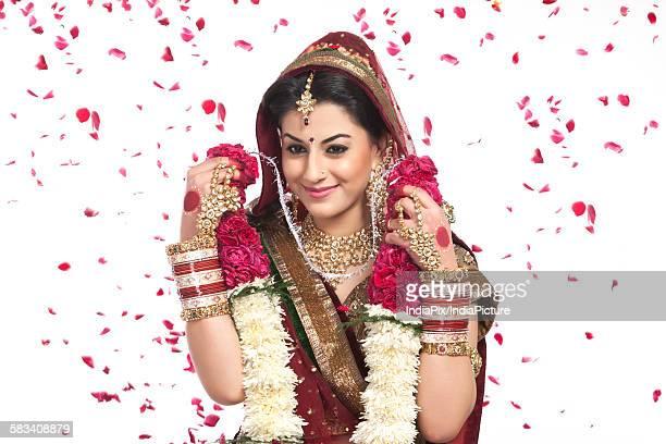 Beautiful bride holding a garland